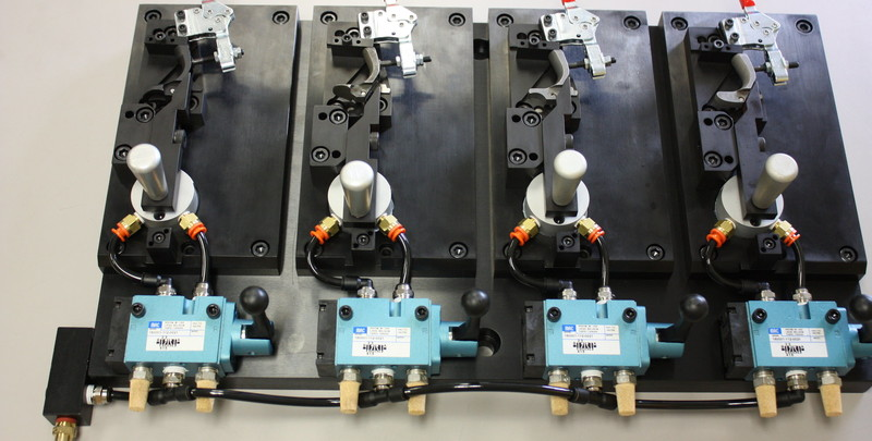 Semi-Automatic work holding fixture with pneumatic clamps.