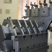 Work holding fixture for 5-axis milling operation.
