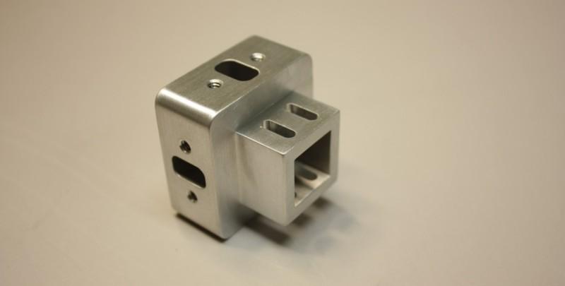 Wire EDM machining in aluminum medical component.